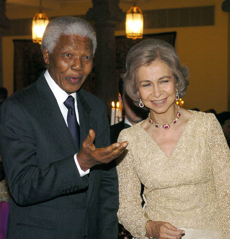 . MADRID, Spain:  Former South African president Nelson Mandela (L) talks with Queen Sofia of Spain during an official dinner at the Pardo Palace 21 May 2004 on the eve of the wedding of Spanish Crown Prince Felipe of Bourbon and Letizia Ortiz. (ALBERTO MARTIN/AFP/Getty Images)