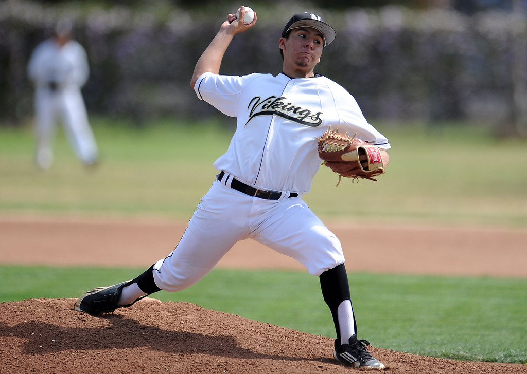 Description of . Northview starting pitcher Niko Castaneda throws to the plate in the first inning of a prep baseball game against Baldwin Park at Northview High School on Tuesday, April 23, 2012 in Covina, Calif. Northview won 8-2.    (Keith Birmingham/Pasadena Star-News)