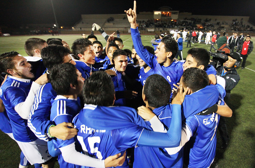 Description of . The El Rancho Dons Boy Soccer Team celebrate after defeating the San Clemente Triton 3-0 in the Division 1 CIF Playoff Tournament, Saturday March 9, 2013 at Warren High School in Downey. (Correspondent photo by Chris Burt/Sports)