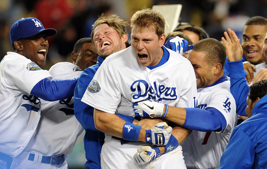 . Los Angeles Dodgers\' A.J. Ellis is mobbed at home plate by teammates after hitting a three run home run to beat the Houston Astros 6-3 in the ninth inning of a baseball game in Los Angeles on Saturday, May 26, 2012.  (Keith Birmingham/Pasadena Star-News)