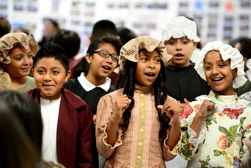 Description of . From left, Edwin Martinez, Maricruz Becerra and Haley Almaraz sing an American folk song at Tracy Elementary School during a fifth-grade Colonial Festival Tuesday morning, March 26, 2013 at the Baldwin Park school. In one month the students completed a report, learned two songs and two dances. Grecia Herrera, the school's nutritional aid, made the dresses and boys' suits. (SGVN/Staff Photo by Sarah Reingewirtz)