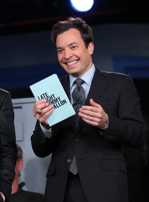 """. This Feb. 18, 2013 photo released by NBC shows Jimmy Fallon, host of \""""Late Night with Jimmy Fallon,\"""" on the set in New York. As Jay Leno lobs potshots at ratings-challenged NBC in his \""""Tonight Show\"""" monologues, speculation is swirling the network is taking steps to replace the host with Jimmy Fallon next year and move the show from Burbank to New York.  NBC confirmed Wednesday, March 20, it\'s creating a new studio for Fallon in New York, where he hosts \""""Late Night.\"""" But the network did not comment on a report that the digs at its Rockefeller Plaza headquarters may become home to a transplanted, Fallon-hosted \""""Tonight Show.\""""  (AP Photo/NBC, Lloyd Bishop)"""