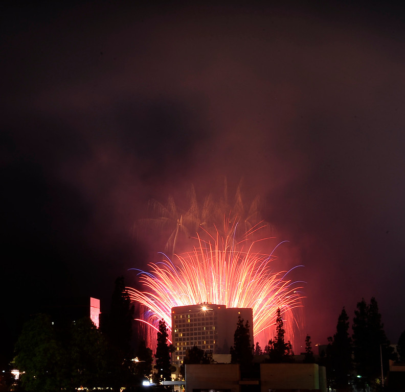 . July 4,2013 Woodland Hills.   Fireworks light up the night during the July Fourth Fireworks  at Warner Center Park Extravaganza: Keyes Automotive Group co-sponsors the event with music by the Los Angeles Pierce Symphonic who performed  Photo by Gene Blevins/LA Daily News