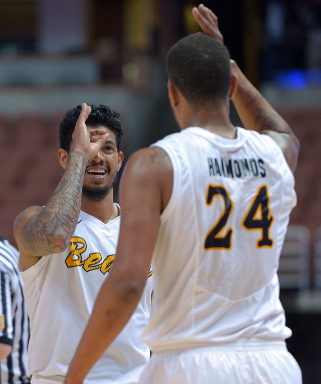 . After scoring a 3-pointer, LBSU\'s Tyler Lamb, left, is congratulated by Travis Hammonds at the Honda Center in Anaheim, CA on Thursday, March 13, 2014. Long Beach State vs CSU Fullerton in the Big West men\'s basketball tournament. 2nd half. LBSU won 66-56.  Photo by Scott Varley, Daily Breeze)