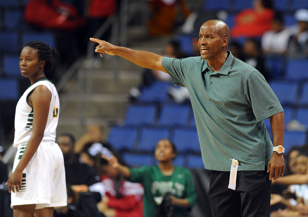 . Poly coach Carl Buggs calls out instructions to his players at Citizens Business Bank Arena in Ontario, CA on Saturday, March 22, 2014. Long Beach Poly vs Etiwanda in the CIF girls open division regional final. 2nd half, Poly won 56-46. Photo by Scott Varley, Daily Breeze)