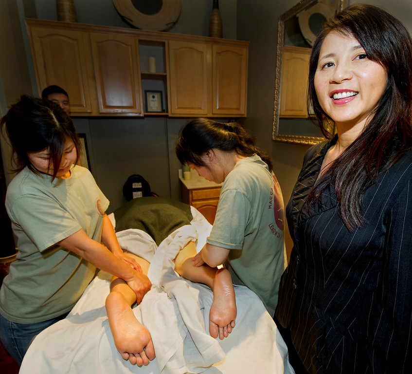 Description of . Alice Taylor, right, Director of AcuSpa and Massage School of Pasadena with two of her students Mayumi Yasunaga of Azusa, left, and Annie Ruimin Vitzthum that is located at 350 South Lake Avenue in Pasadena Thursday, April 17, 2014.(Photo by Walt Mancini/Pasadena Star-News)
