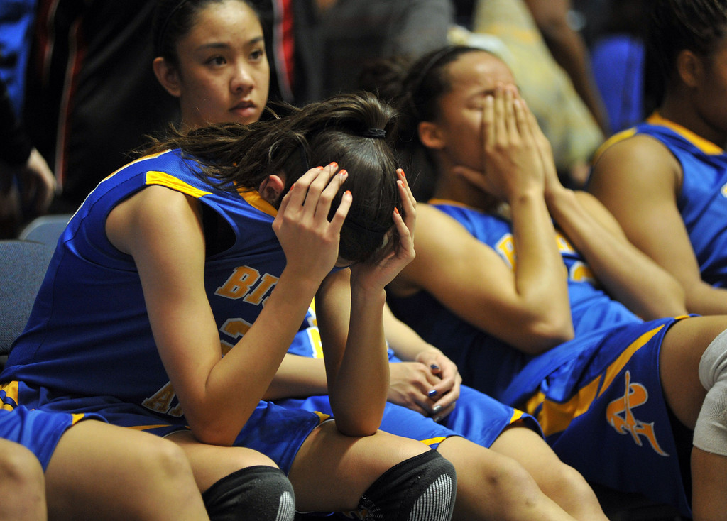 Description of . Bishop Amat's Paulina Santana (#21), left, and Mauriana Clayton (#23), right, react after their loss to Canyon Springs in the CIF-SS Division 1A girls basketball finals at the Anaheim Arena on Friday February 28, 2013. Canyon Springs beat Bishop Amat 48-46. (SGVN/Staff Photo by Keith Durflinger)
