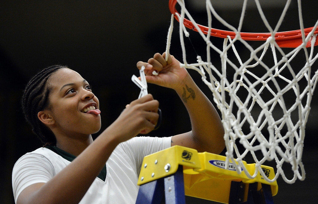Description of . Cal Poly Pomona's Ashley Lovett cuts the net after Cal Poly defeated Montana State Billings during the NCAA Division II West Regional championship game at Cal Poly Pomona in Pomona, CA, Monday, March 17, 2014. (Photo by Jennifer Cappuccio Maher/Inland Valley Daily Bulletin)
