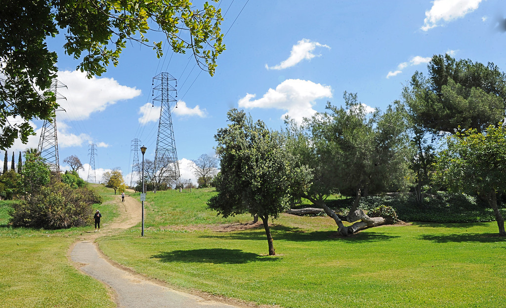 Description of . Monterey Park may lose a park and hiking trail that has shared with Southern California Edison for nearly five decades.  Edison has doubled its tower setback requirements, which means Monterey Park will have to cut down a 112 trees or lose access to Edison Trails Park, according to a petition letter Councilwoman Teresa Real Sebastian authored. About a dozen residents may have to change the landscaping on their private property because of the new restrictions. More than 450 residents have signed the petition, which is addressed to SCE Pressident Litzinger.(Photo by Walt Mancini/Pasadena Star-News)