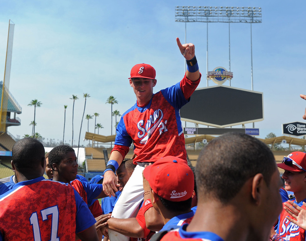 . Serra\'s Trent Hammond (21), a transfer from Mira Costa celebrates his team\'s win over his former in the CIF-SS Division III championship baseball game Friday at Dodger Stadium. Hammond took a lot of rough comments from the fans during the game. Serra won the title, 8-1. 20130531 Photo by Steve McCrank / Staff Photographer