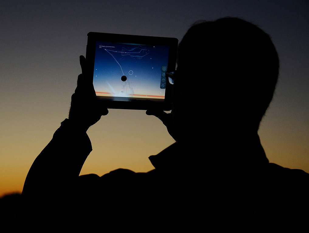 Description of . David Schaefer, from Pasadena, uses his iPad to help him lineup and find the comet Pan-STARRS.  The comet will be visible through the end of March.