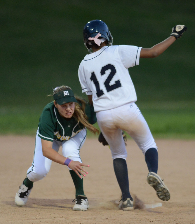 . Moorpark\'s Madison Fleming (6) makes the force out on North\'s Lexi Hendon (12) at second in a pool play softball game of the TNT Tournament at Wilson Park in Torrance. 20130321 Photo by Steve McCrank / Staff Photographer