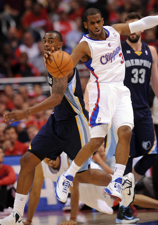 . Clippers guard Chris Paul grabs a loose ball against the Memphis Grizzlies during game 2 of the 2013 NBA Western Conference Playoffs April 22, 2013 in Los Angeles, CA.(Andy Holzman/Staff Photographer)