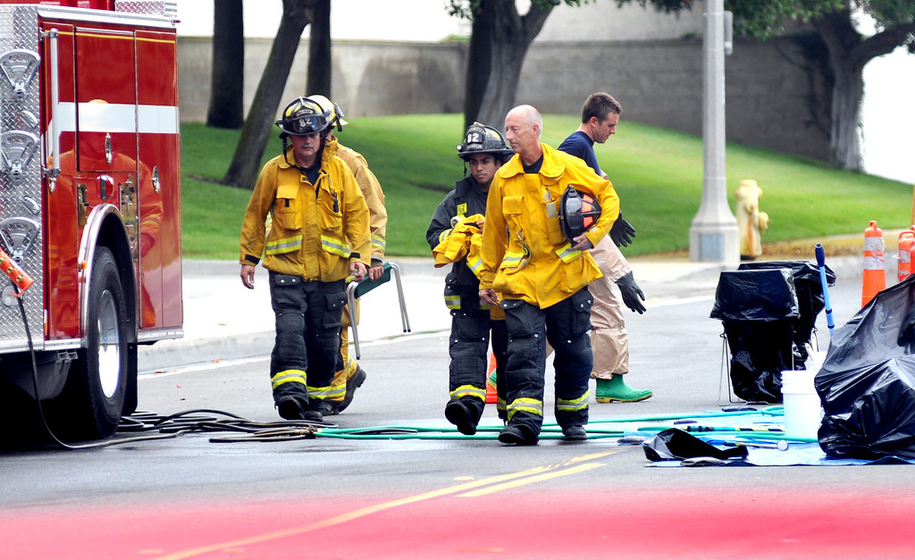 Description of . Santa Fe Springs Hazardous Materials crew members and Firefighters respond to a leaking chemical barrel containing Ethylenediamine that created a cloud at Central Transport on the 12200-block of Clark Street in Santa Fe Springs on Thursday July 11, 2013. Employees were evacuated after the barrel was punctured by a forklift causing at least 50-gallons of the chemical to spill. No injuries were reported in the incident. (SGVN/Staff Photo by Keiht Durflinger)