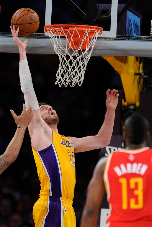 . Lakers#16 Pau Gasol lays up a shot in the first quarter. The Lakers faced the Houston Rockets in the final home game of the year at Staples Center in Los Angeles, CA 4/17/2013(John McCoy/Staff PhotographerThe Lakers faced the Houston Rockets in the final home game of the year at Staples Center in Los Angeles, CA 4/17/2013(John McCoy/Staff Photographer