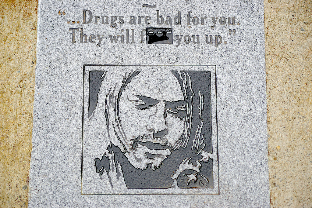 . A memorial plaque sits in the ground at Kurt Cobain Riverfront Park in Aberdeen, Wash. on Friday, Aug. 7, 2009. The granite plaque stirred controversy because of an obscenity in a quote by Cobain etched into the memorial. The last three letters of the word were removed Thursday and replaced with dashes before the Aberdeen City Council could weigh in on the issue. (AP Photo/The Daily World, Dan Jackson)