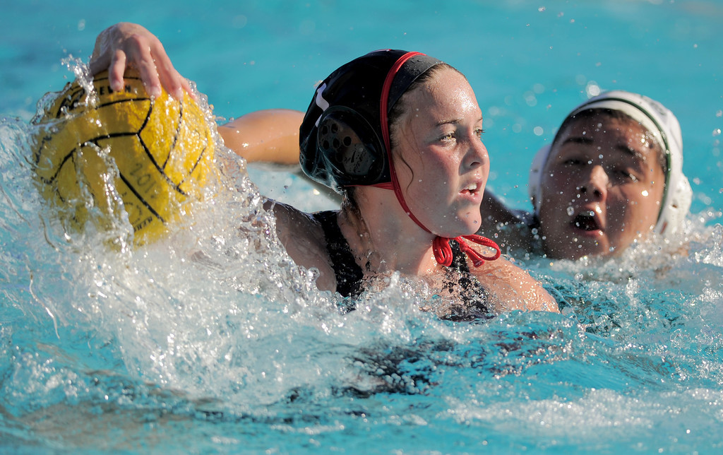 . 02-16-2012--(LANG Staff Photo by Sean Hiller)- Palos Verdes girls water polo defeated Upland 10-8 in Saturday\'s CIF Southern Section Division III quarterfinal at Palos Verdes High School. PV\'s Kendyl Johnson (7) looks for an open shot against Upland\'s Ashley Paz.