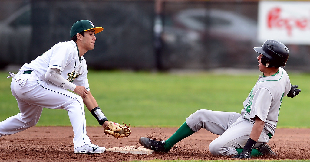 . Monrovia\'s Nick Carino (2) safely slides to second as Temple City\'s Sergio Juarez (14) tries to out him during the Arcadia Elks Tournament Thursday, March 7, 2013 at Temple City High School.  (SGVN/Staff Photo by Sarah Reingewirtz)