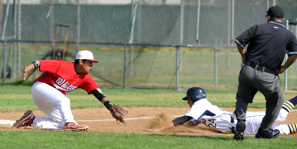Description of . Whittier third baseman Cody Carmona (#19) tags out California's Robert Blount (#24) at third base in their Del Rio League game at California High School in Whittier on Friday March 22, 2013. California beat Whittier 6-0. (SGVN/Staff Photo by Keith Durflinger)