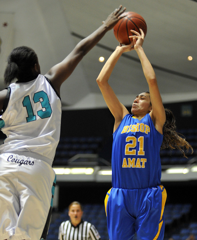 Description of . Bishop Amat's Paulina Santana (#21) jumps for a shot as they play Canyon Springs in the CIF-SS Division 1A girls basketball finals at the Anaheim Arena on Friday March1, 2013. Canyon Springs beat Bishop Amat 48-46. (SGVN/Staff Photo by Keith Durflinger)