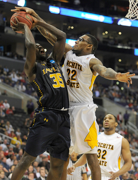 . La Salle #35 Rohan Brown has a shot blocked by Wichita #22 Carl Hall in the first half. La Salle played Wichita State at Staples Center for the West Regional of the NCAA Division I Men\'s Basketball Championships. Los Angeles,CA 3/28/2013(John McCoy/Staff Photographer