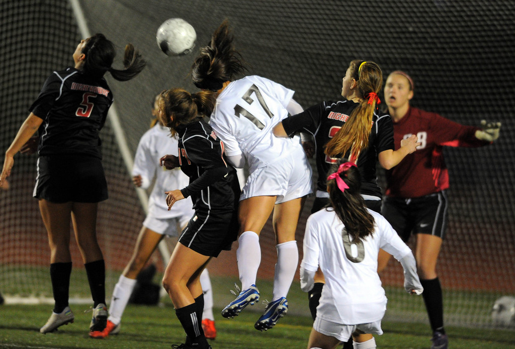 . TORRANCE - 02/12/2013 - (Staff Photo: Scott Varley/LANG) West High girls soccer beat Murrieta Valley on penalty kicks in their CIF Southern Section Division II wild-card matchup. After a 0-0 tie, West won 3-1 on PKs. West\'s Lauren Kai (17) heads the ball on a free kick but was caught by the MV goalie.