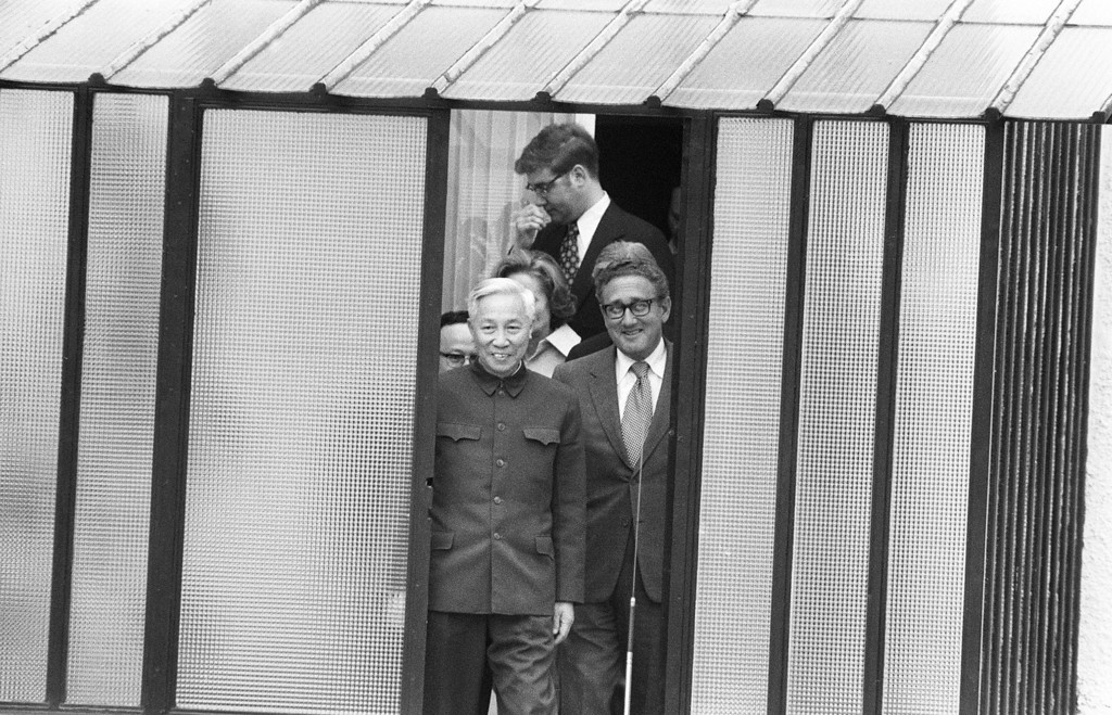 Description of . PARIS, FRANCE - JANUARY 23, 1973:  US National Security Adviser Henry Kissinger (R) and Le Duc Tho, leader of North Vietnam delegation, leave the house where they met regarding the enforcement of the Paris Peace Accords, 23 January 1973 in Paris, France. (Photo by AFP/Getty Images)