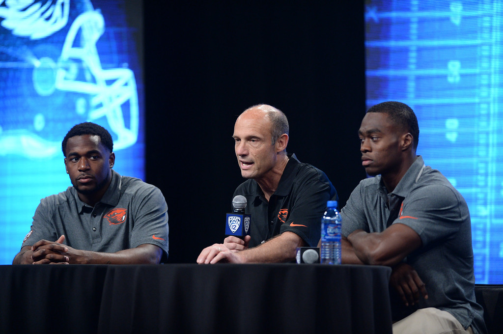 . Oregon State Coach Mike Riley, center, with players Brandon Cooks and Rashad Reynold. Pac12 media Day at Sony Studios.  Photo by Brad Graverson 7-26-13