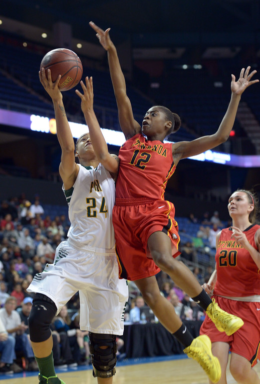 . Poly\'s Emoni Jackson is fouled by Etiwanda\'s Kyla Martin at Citizens Business Bank Arena in Ontario, CA on Saturday, March 22, 2014. Long Beach Poly vs Etiwanda in the CIF girls open division regional final. 1st half, Photo by Scott Varley, Daily Breeze)