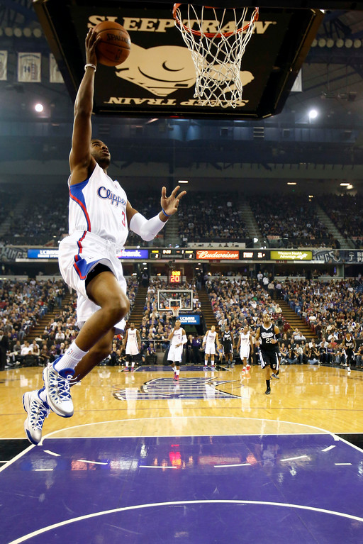 . Los Angeles Clippers guard Chris Paul goes for the breakaway layup during the first quarter of an NBA basketball game against the Sacramento Kings in Sacramento, Calif., Wednesday, April 17, 2013. (AP Photo/Rich Pedroncelli)