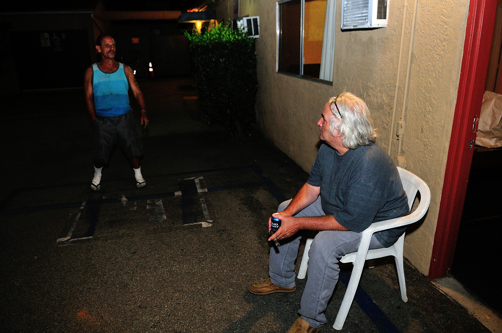. El Capitan handyman/chief of security, David, appears from the darkness to explain the rules of the motel to Tim Grobaty. Photo by Thomas Wasper for the Press Telegram