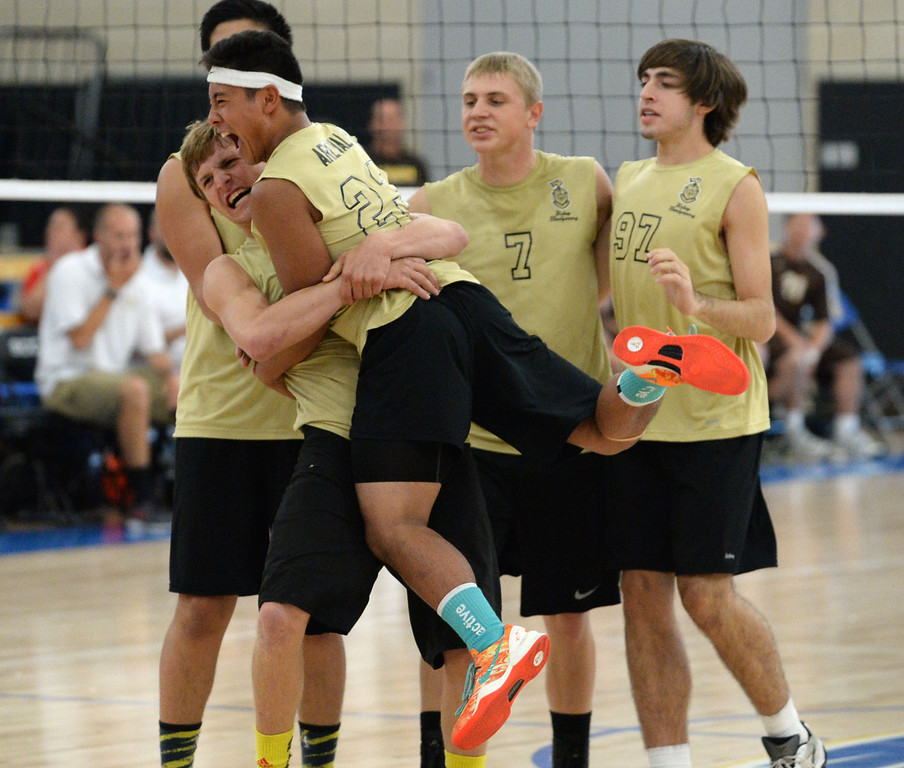 . Bishop Montgomery\'s Justin Arevalo (23) and Eddie Specht (1) celebrate a point in a close fifth game after battling back from losing the first and second set against Parker in a Southern California Regional Division III Final volleyball match Saturday at Santiago Canyon College in Orange. The match came down to the final points of the fifth game, with Bishop Montgomery losing the heart-breaker. Bishop Montgomery vs. Francis Parker (San Diego) 20130525 Photo by Steve McCrank / Staff Photographer