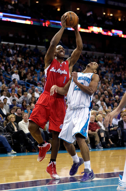 . Los Angeles Clippers reserve guard Chauncey Billups (1) shoots against New Orleans Hornets guard Brian Roberts (22) in the first half of an NBA basketball game in New Orleans, Wednesday, March 27, 2013. Billups, who is came back from a strained right groin, missed the Clippers\' past three games. (AP Photo/Gerald Herbert)
