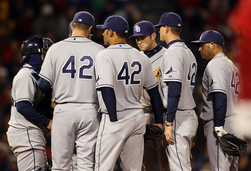 Description of . BOSTON - APRIL 16:  The Tampa Bay Rays gather on the pitchers mound in the fourth inning against the Boston Red Sox on April 16, 2010 at Fenway Park in Boston, Massachusetts. The Tampa Bay Rays wore the number 42 to honor Jackie Robinson. (Photo by Elsa/Getty Images)