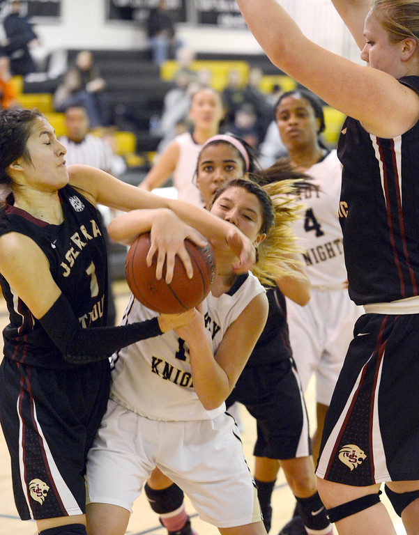 . Bishop Montgomery\'s Christine Delapina (12) finds the going tough under the basket as JSerra\'s Coco Miller (1) strips the ball in a CIF Division IV-AA quarterfinal game Wednesday night in Torrance. 20130220 Photo by Steve McCrank / Staff Photographer