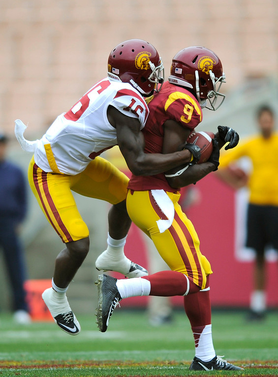 . WR Marqise Lee is wrapped up by CB Anthony Brown during USC\'s Spring Football Game at the L.A. Memorial Coliseum, Saturday, April 13, 2013. (Michael Owen Baker/Staff Photographer)