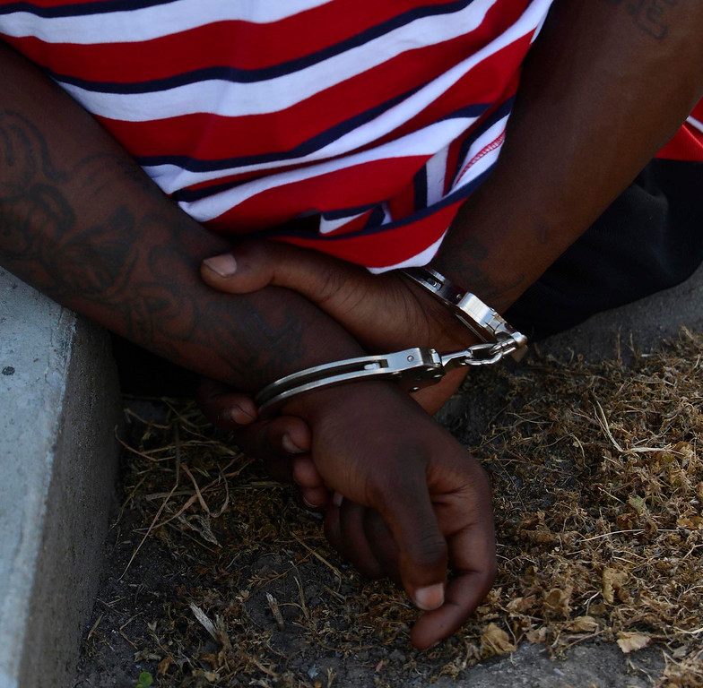 Description of . An unidentified man is arrested because of a probation violation along the 1200 block of N. Genevieve Street in San Bernardino April 4, 2013.   GABRIEL LUIS ACOSTA/STAFF PHOTOGRAPHER.