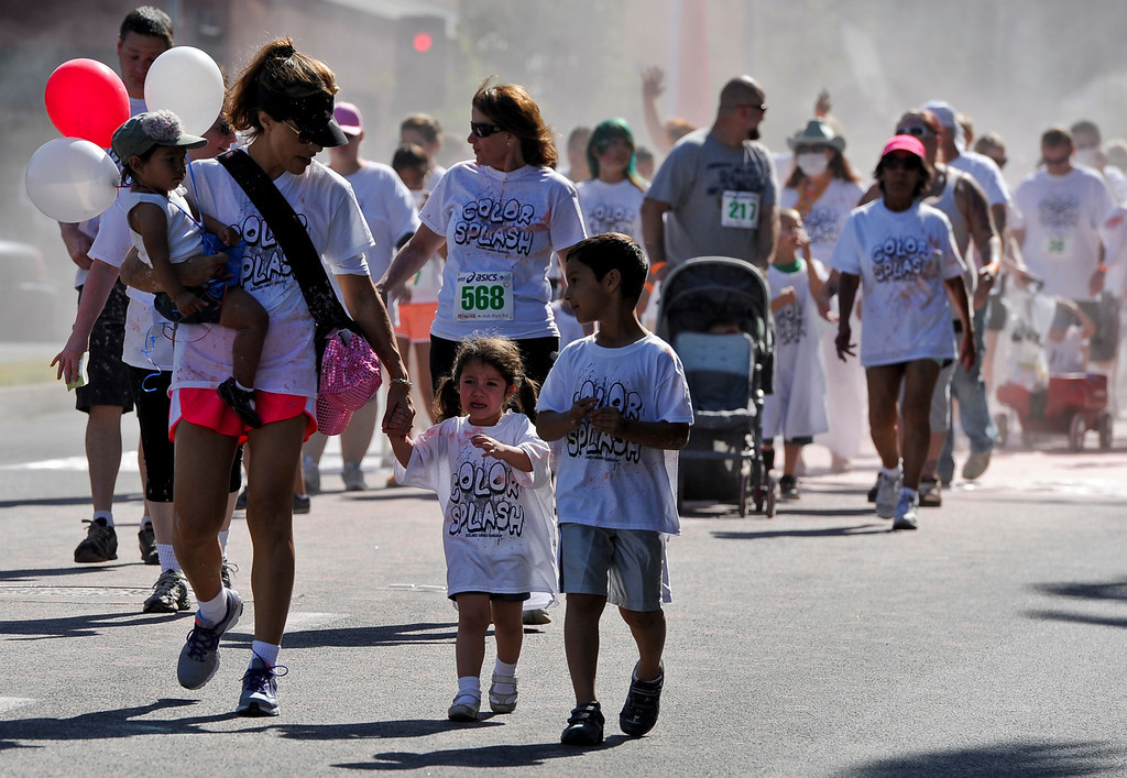 . Runners participate in the first Color Splash race during the 30th annual Run Through Redlands event on Sunday, April 21, 2013. The race proceeds benefited the Kiwanis Club Foundation and scholarship opportunities for high school seniors. (Rachel Luna / Staff Photographer)