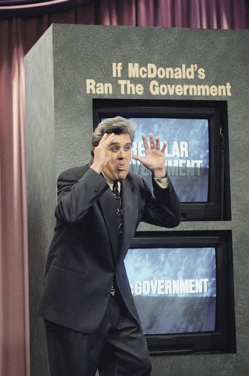 ". LENO SHOW 1993   ""Tonight Show\"" host Jay Leno gestures during a comedy sketch after a joke went wrong and said \""I don\'t care if you don\'t laugh. I got the job. I guess we start renegotiating that contract tomorrow,\"" during the taping of the show in Burbank, Calif., Jan 14, 1993. (AP Photo/Kevork Djansezian)"