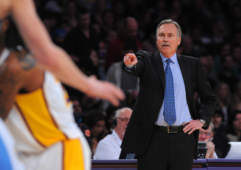 . Lakers coach Mike D\'Antoni makes a call to his players against the Nuggets at the Staple Center in Los Angeles, CA on Sunday, January 5, 2014. 1st half.  (Photo by Scott Varley, Daily Breeze)