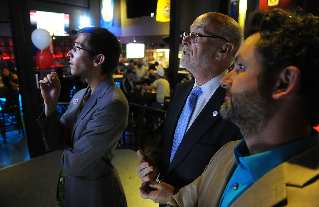 . Torrance mayoral candidate Pat Furey, center and his son, Patrick, right, look over early result numbers at his election night party at Industry Bar in Torrance, CA on Tuesday, June 3, 2014. (Photo by Scott Varley, Daily Breeze)