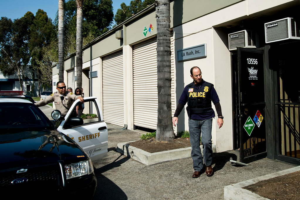 . Federal Food and Drug Administration officers along with Los Angeles County Sheriff\'s officials serve a search warrant to auto parts dealer, L.A. Rush, in Norwalk on Friday, March 22, 2013. The business is suspected of illegally selling nitrous oxide for recreational drug use. (SGVN/Staff photo by Watchara Phomicinda)
