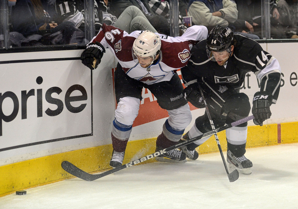 . The Kings\' Justin Williams #14 and the Avalanche\'s Stefan Elliott #46 during their game at the Staples Center in Los Angeles Thursday, April 11, 2013.(Hans Gutknecht/Staff Photographer)