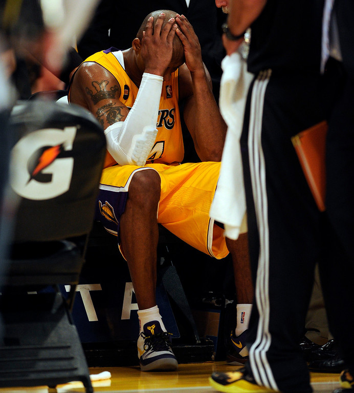 . The Lakers\' Kobe Bryant #24 sits sits on the bench after hurting his ankle during their game against the Warriors at the Staples Center in Los Angeles Friday, April 12, 2013. The Lakers beat the Warriors 118-116. (Hans Gutknecht/Staff Photographer)