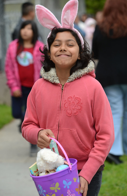 . The Long Beach Rescue Mission served Easter meals and gave out Easter baskets to the children Sunday morning. The mission has been doing so since 1972 and provides food, clothing, shelter and guidance for the homeless and poor.  Kate Aguilera, 9, smiles for a photo after receiving her Easter basket. 20130331 Photo by Steve McCrank / Staff Photographer