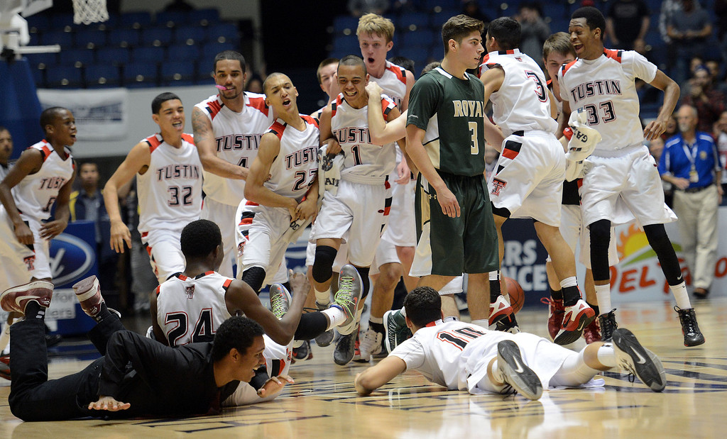 . Tusint players run on to the court as Royal\'s Justin Anderson #3 walks off during their CIF-SS Division III-AAA Boys Basketball Championship at the Anaheim Convention Center Thursday, February 28, 2013. Tustin beat Royal 49-32.  (Hans Gutknecht/Staff Photograpehr)