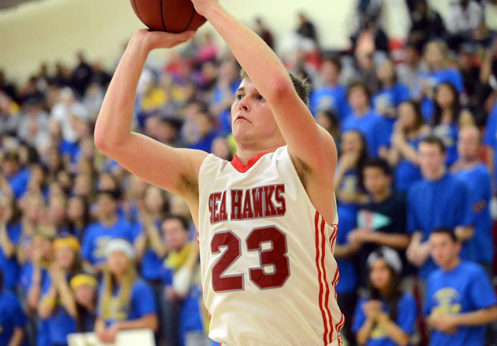 . Redondo Union\'s Derek Biale (23) lines up another three pointer from the corner, with Arroyo Grande fans watching, in a CIF Southern Section Division II-A semifinal boys basketball game Tuesday night in Redondo Beach. 20130226 Photo by Steve McCrank / Staff Photographer