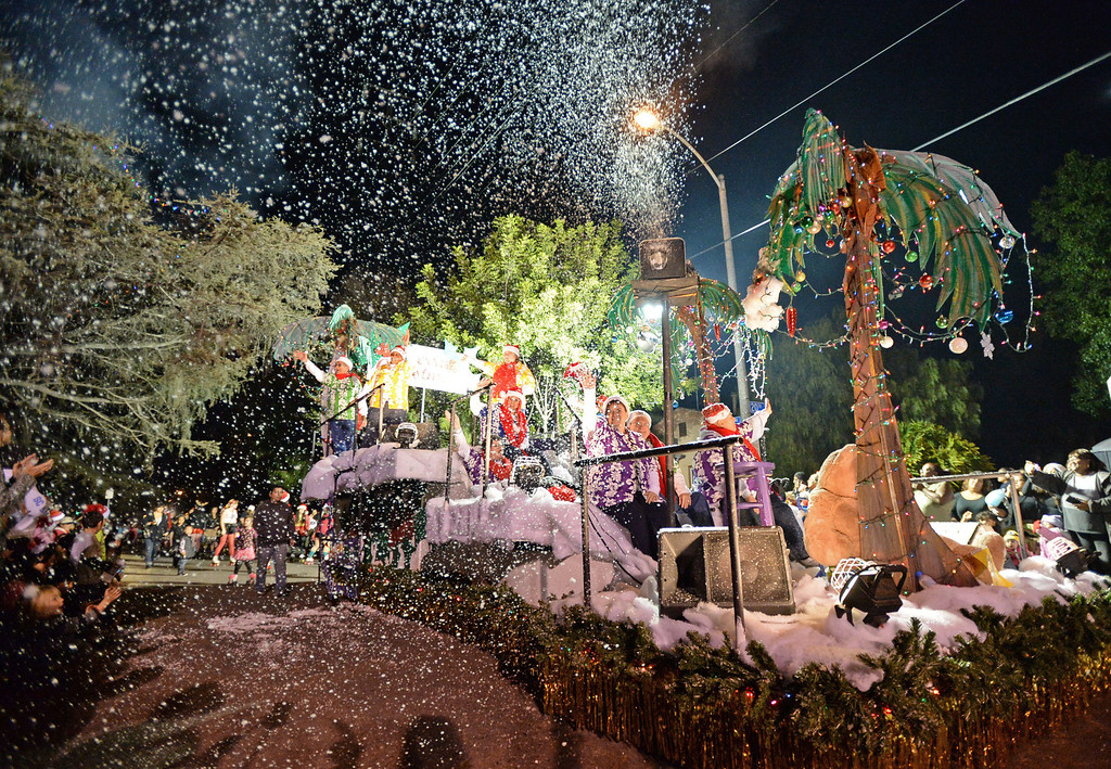 . The 60th annual Daisy Avenue Parade in the Wrigley neighborhood Saturday, December 13, 2013, in Long Beach, CA.   The Long Beach Lesbian and Gay Pride float features a combination of snow and palm trees. Photo by Steve McCrank/DailyBreeze
