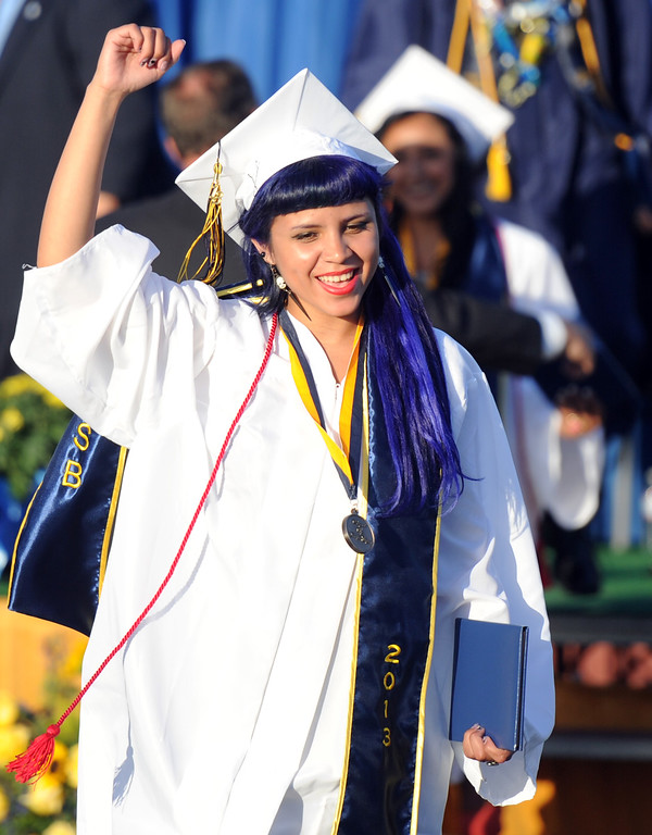 Description of . Graduate Bianca Recendez celebrates after receiving her diploma during the Montebello High School commencement at Montebello High School on Thursday, June 20, 2013 in Montebello, Calif.  (Keith Birmingham/Pasadena Star-News)