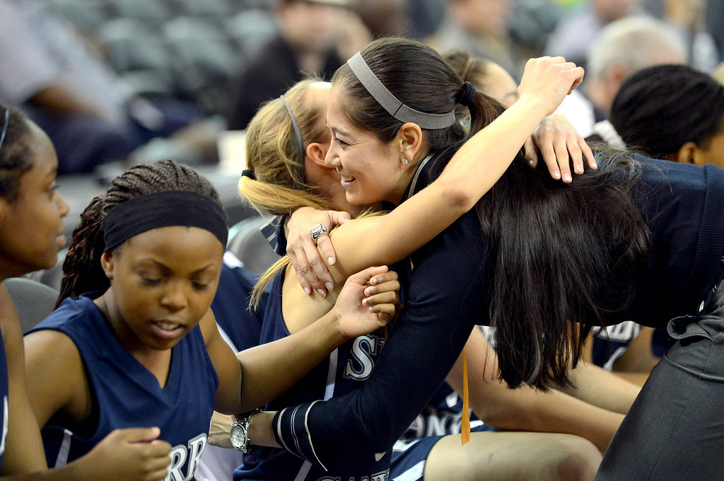 . Sierra Canyon girls basketball head coach Alicia Komaki congratulates a player following their game against Pinewood High School during the 2013 CIF State Basketball Championships at the Sleep Train Arena, in Sacramento, Ca March 22, 2013.  Sierra Canyon won the game 47-33.(Andy Holzman/Los Angeles Daily News)